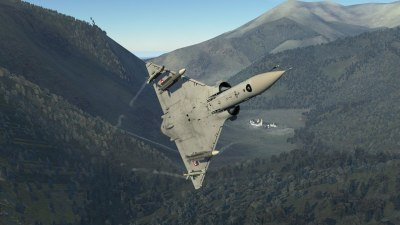 A Mirage 2000C banks tightly through the mountains