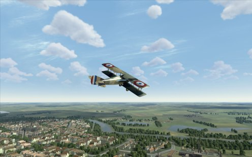 Spad XIII over a French village