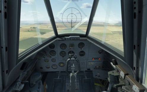 The cockpit and the VV-1 mechanical gunsight.