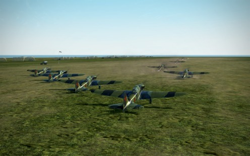 Two formations of IL-2s take-off on a maximum effort strike.